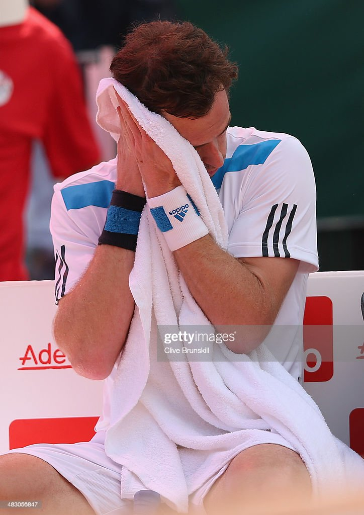 Andy Murray of Great Britain shows his dejection in the changeover during his straight sets defeat in the fourth rubber by Fabio Fognini of Italy during day three of the Davis Cup World Group Quarter Final match between Italy and Great Britain at Tennis Club Napoli on April 6, 2014 in Naples, Italy.