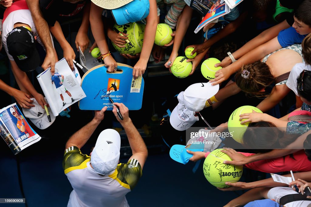 <a gi-track='captionPersonalityLinkClicked' href=/galleries/search?phrase=Andy+Murray+-+Tennis+Player&family=editorial&specificpeople=200668 ng-click='$event.stopPropagation()'>Andy Murray</a> of Great Britain signs an autograph after winning his second round match against Joao Sousa of Portugal during day four of the 2013 Australian Open at Melbourne Park on January 17, 2013 in Melbourne, Australia.