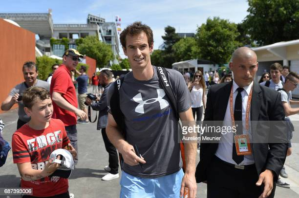 Andy Murray of Great Britain signs autographs as he arrives for a training session at the 2017 French Open at Roland Garros on May 23 2017 in Paris...