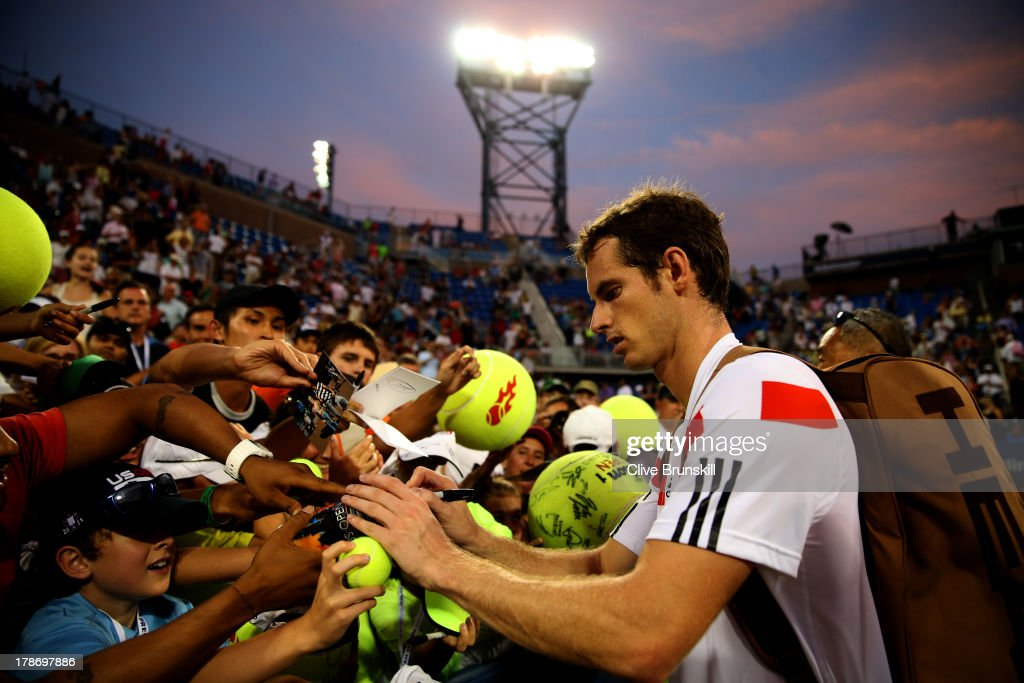 Andy Murray of Great Britain signs autographs for fans after his victory during his men's singles second round match against Leonardo Mayer of Argentina on Day Five of the 2013 US Open at USTA Billie Jean King National Tennis Center on August 30, 2013 in the Flushing neighborhood of the Queens borough of New York City.