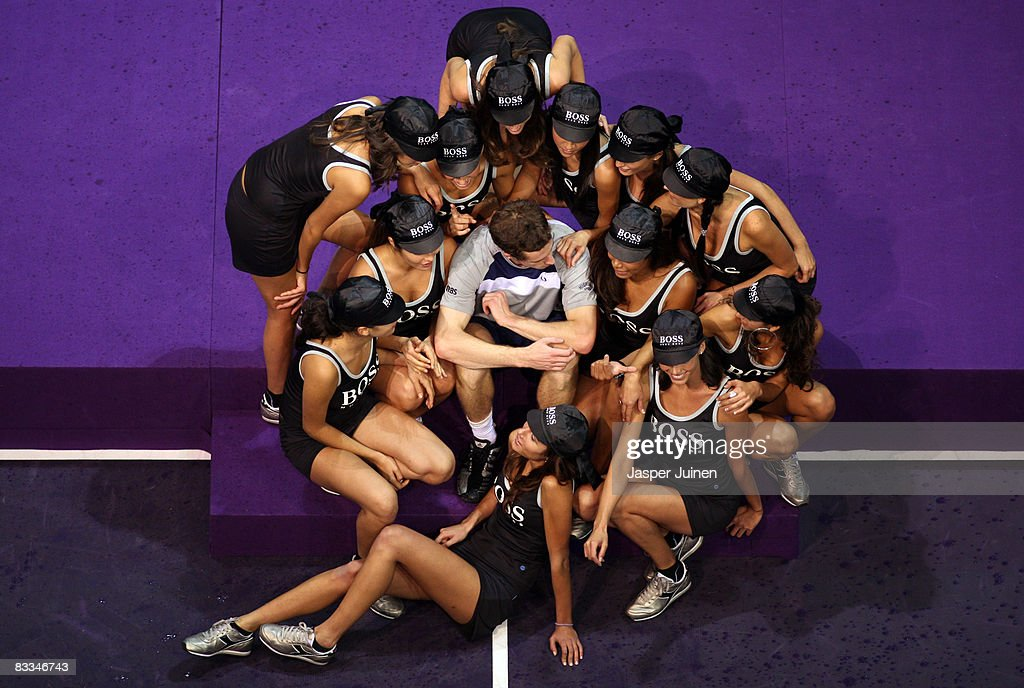Andy Murray of Great Britain sits amid model ballgirls after his final Madrid Masters tennis tournament match against Gilles Simon of France at the Madrid Arena on October 19, 2008 in Madrid, Spain. Murray won the match in straight sets, 6-4 and 7-6.