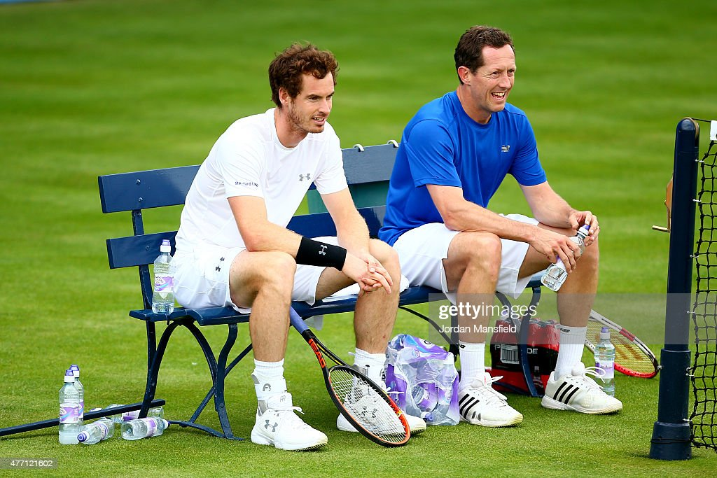 Andy Murray of Great Britain sits with his coach Jonas Bjorkman of Sweden during a practice session ahead of the Aegon Championships at the Queens Club on June 14, 2015 in London, England.