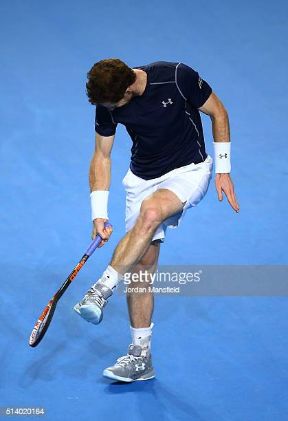 Andy Murray of Great Britain smashes his racquet during the singles match against Kei Nishikori of Japan on day three of the Davis Cup World Group...