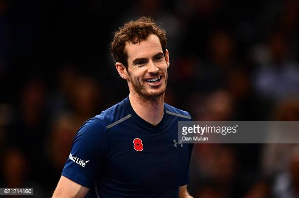 Andy Murray of Great Britain smiles on court following his walkover in the Mens Singles semi final match against Milos Raonic of Canada on day six of...