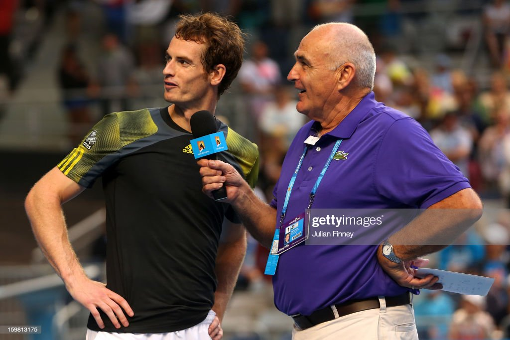 Andy Murray of Great Britain speaks to commentator Stephen Phillips after winning his fourth round match against Gilles Simon of France during day eight of the 2013 Australian Open at Melbourne Park on January 21, 2013 in Melbourne, Australia.