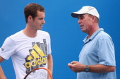 Andy Murray of Great Britain speaks to his coach Ivan Lendl during practice ahead of the 2014 Australian Open at Melbourne Park on January 12 2014 in...