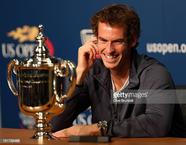 Andy Murray of Great Britain speaks to members of the media next to the US Open championship trophy during a press conference after defeating Novak...