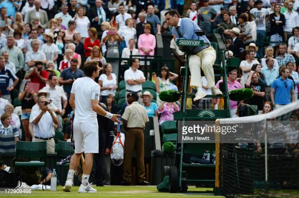 Andy Murray of Great Britain speaks with Chair Umpire Jake Garner after Championships' referee Andrew Jarrett announced the decision to close the...