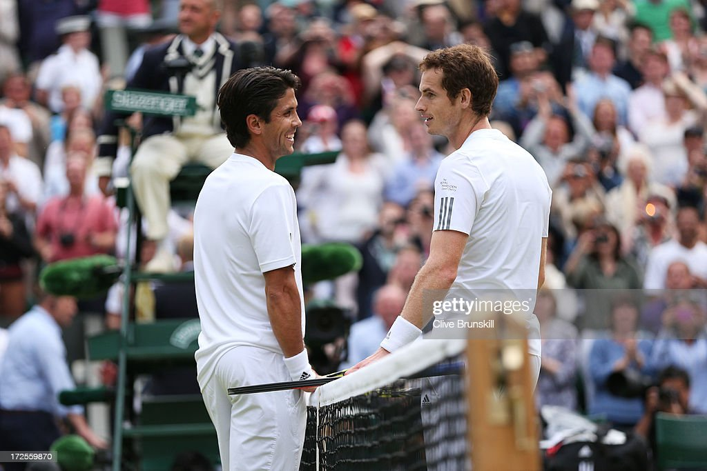 <a gi-track='captionPersonalityLinkClicked' href=/galleries/search?phrase=Andy+Murray+-+Tennis+Player&family=editorial&specificpeople=200668 ng-click='$event.stopPropagation()'>Andy Murray</a> of Great Britain speaks with Fernando Verdasco of Spain at the net after the Spaniard challenged the final call of the match during the Gentlemen's Singles quarter-final match against Fernando Verdasco of Spain on day nine of the Wimbledon Lawn Tennis Championships at the All England Lawn Tennis and Croquet Club at Wimbledon on July 3, 2013 in London, England.