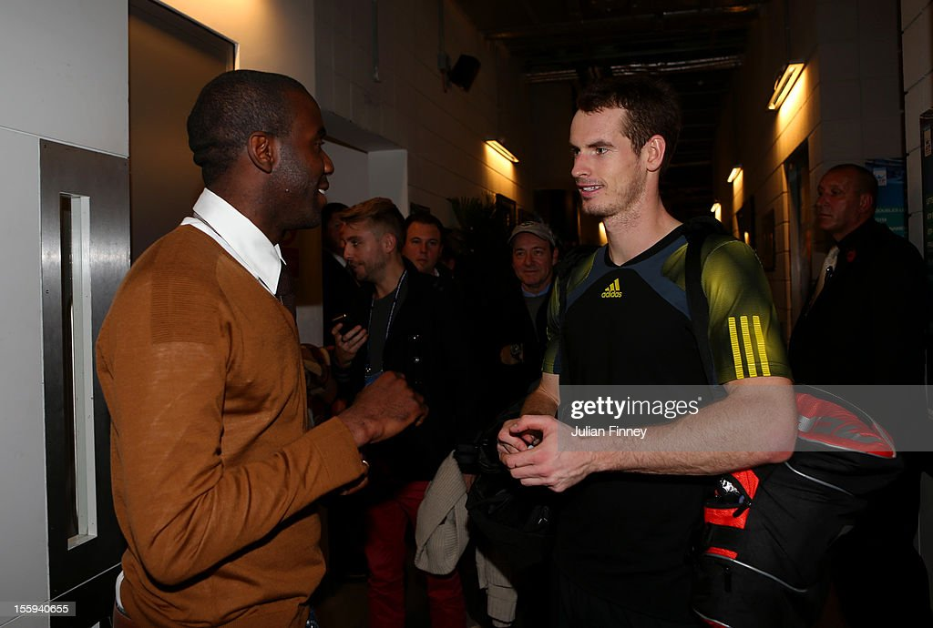 Andy Murray of Great Britain speaks with former Premier League footballer <a gi-track='captionPersonalityLinkClicked' href=/galleries/search?phrase=Fabrice+Muamba&family=editorial&specificpeople=745514 ng-click='$event.stopPropagation()'>Fabrice Muamba</a> after his men's singles match against Jo-Wilfried Tsonga of France on day five of the ATP World Tour Finals at O2 Arena on November 9, 2012 in London, England.