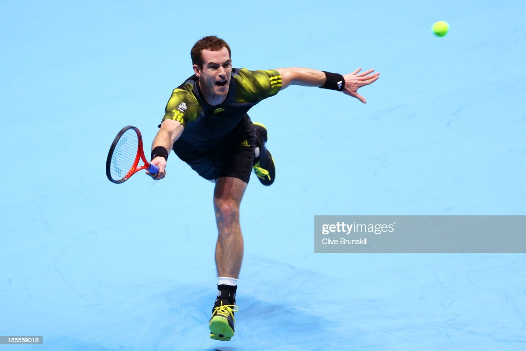 Andy Murray of Great Britain stretches for a forehand during the men's singles match against Tomas Berdych of Czech Republic on day one of the ATP World Tour Finals at the O2 Arena on November 5, 2012 in London, England.