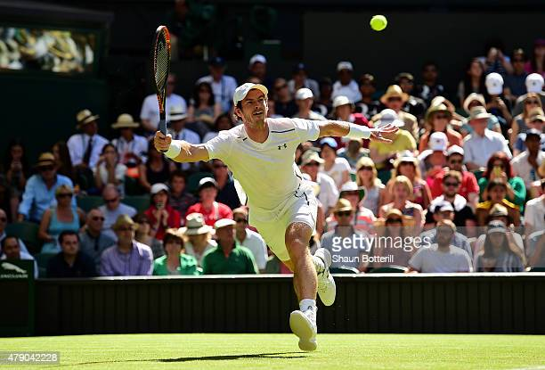 Andy Murray of Great Britain stretches for a forehand in his Gentlemen's Singles first round match against Mikhail Kukushkin of Kazakhstan during day...