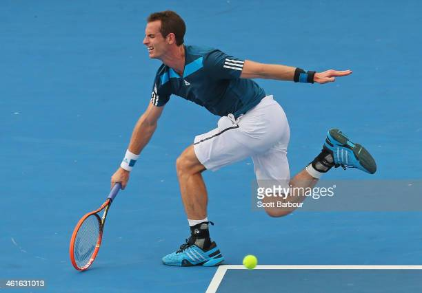 Andy Murray of Great Britain stretches for the ball during his match against Lleyton Hewitt of Australia during day three of the AAMI Classic at...