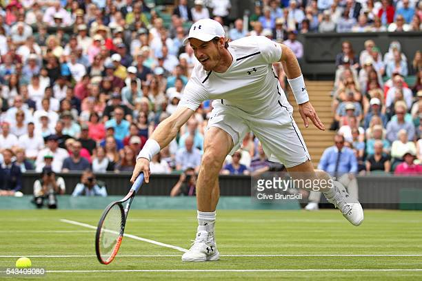 Andy Murray of Great Britain stretches to attempt a backhand during the Men's Singles first round match against Liam Broady of Great Britain on day...