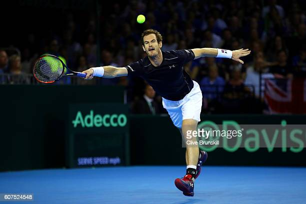 Andy Murray of Great Britain stretches to hit a forehand during his singles match against Guido Pella of Argentina during day three of the Davis Cup...