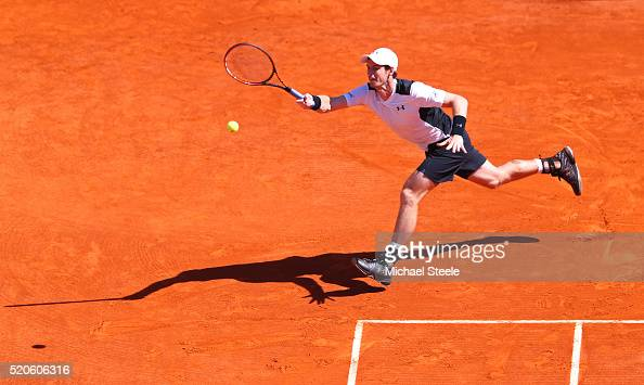 Andy Murray of Great Britain stretches to hit a forehand during the second round match against PierreHughes Herbert of France on day three of the...