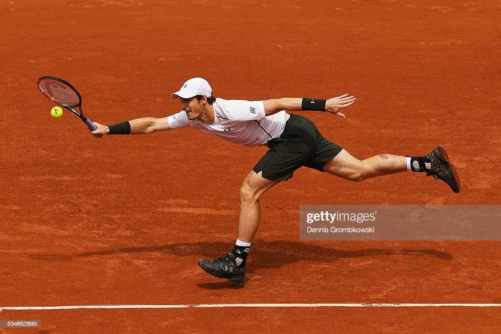 <a gi-track='captionPersonalityLinkClicked' href=/galleries/search?phrase=Andy+Murray+-+Tennis+Player&family=editorial&specificpeople=200668 ng-click='$event.stopPropagation()'>Andy Murray</a> of Great Britain stretches to hit a forehand during the Men's Singles third round match against Ivo Karlovic of Croatia on day six of the 2016 French Open at Roland Garros on May 27, 2016 in Paris, France.