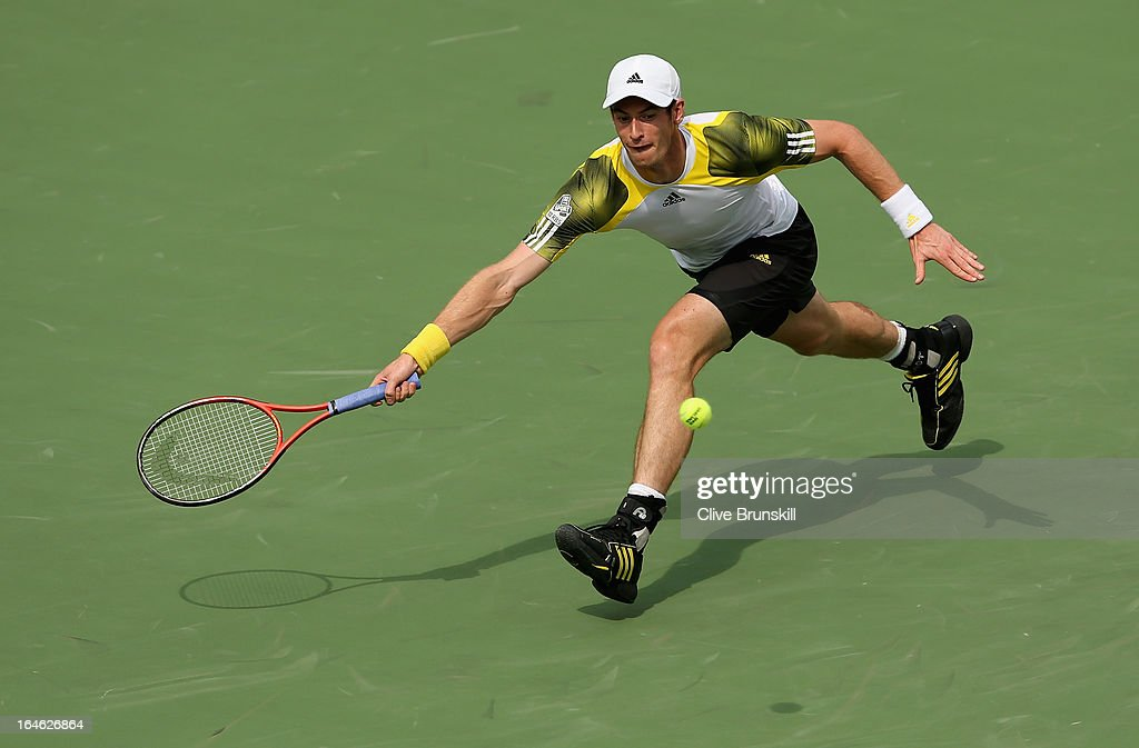 <a gi-track='captionPersonalityLinkClicked' href=/galleries/search?phrase=Andy+Murray+-+Tennis+Player&family=editorial&specificpeople=200668 ng-click='$event.stopPropagation()'>Andy Murray</a> of Great Britain stretches to play a forehand against Grigor Dimitrov of Bulgaria during their third round match at the Sony Open at Crandon Park Tennis Center on March 25, 2013 in Key Biscayne, Florida.