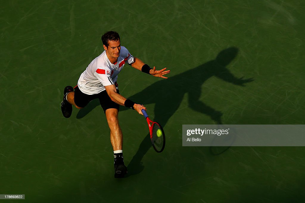 Andy Murray of Great Britain stretches to play a forehand during his men's singles second round match against Leonardo Mayer of Argentina on Day Five of the 2013 US Open at USTA Billie Jean King National Tennis Center on August 30, 2013 in the Flushing neighborhood of the Queens borough of New York City.