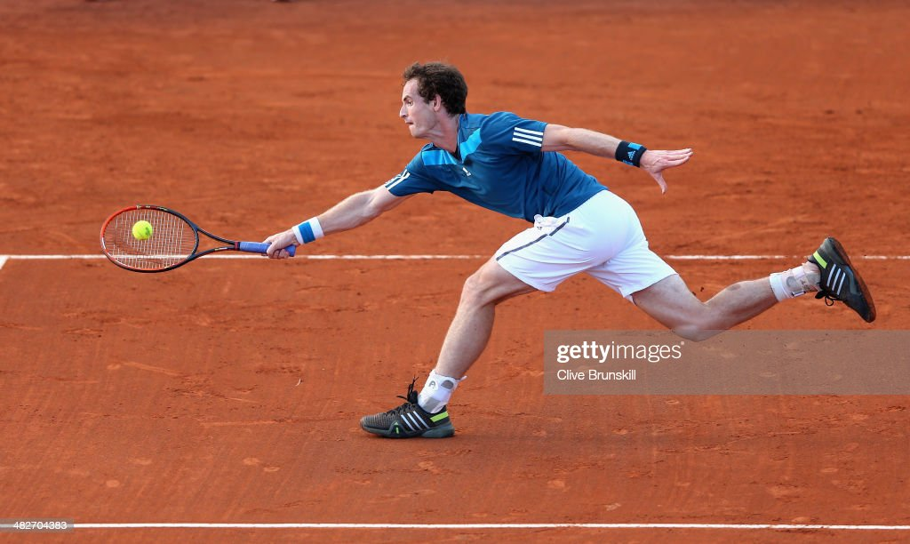 Andy Murray of Great Britain stretches to play a forehand volley against Andreas Seppi of Italy during day one of the Davis Cup World Group Quarter Final match between Italy and Great Britain at Tennis Club Napoli on April 4, 2014 in Naples, Italy.