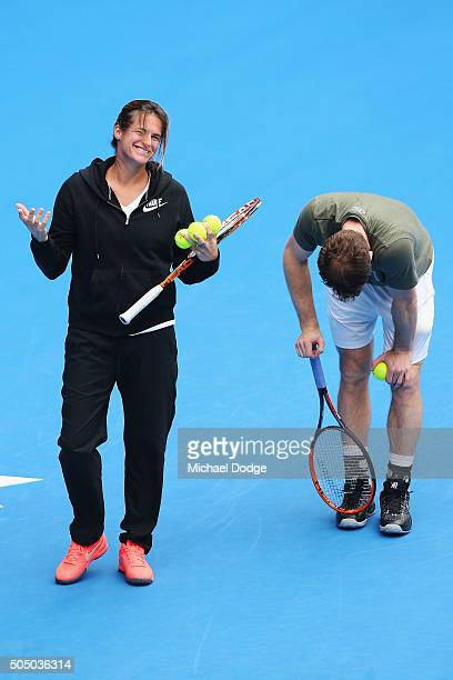 Andy Murray of Great Britain takes a moment to pause after his coach Amelie Mauresmo who gestures threw a ball and hit him during a practice session...