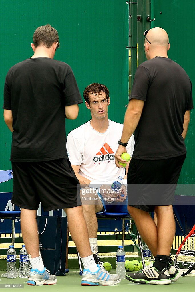 Andy Murray of Great Britain talks to Andy Ireland and Jez Green after his practice during the Shanghai Rolex Masters at the Qi Zhong Tennis Center on October 9, 2012 in Shanghai, China.