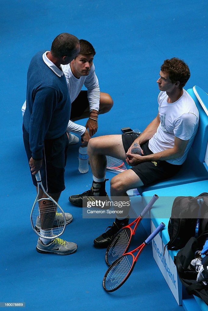 Andy Murray of Great Britain talks to his coach Ivan Lendl with Daniel Vallverdu and Jez Green, in a practice session during day thirteen of the 2013 Australian Open at Melbourne Park on January 26, 2013 in Melbourne, Australia.