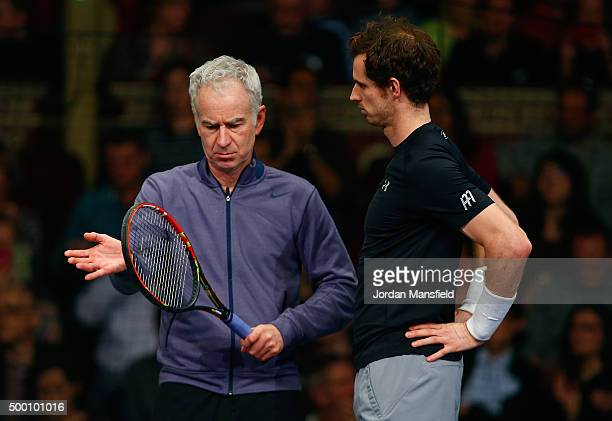 Andy Murray of Great Britain talks with John McEnroe of the USA during the Tie Break Tens on day four of the Masters Tennis at the Royal Albert Hall...