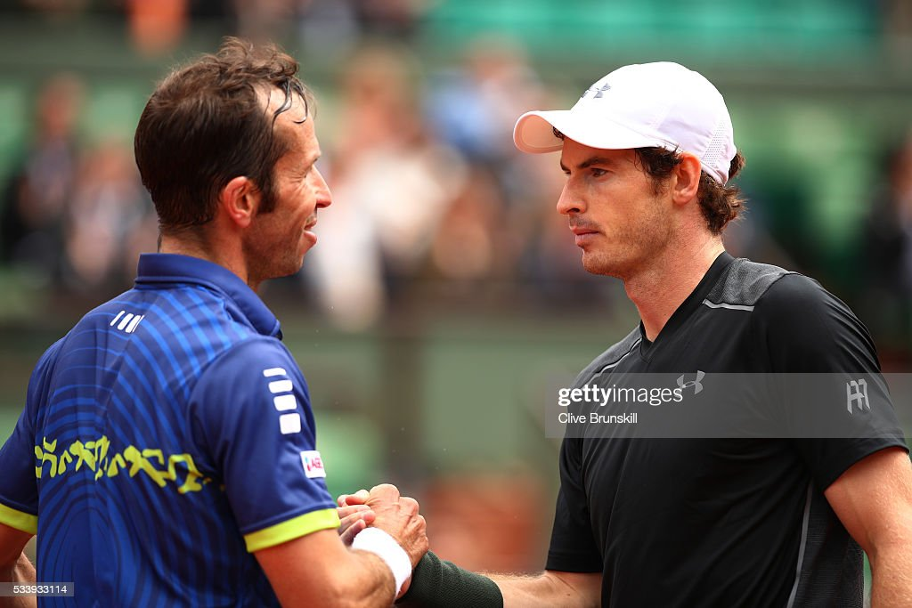 <a gi-track='captionPersonalityLinkClicked' href=/galleries/search?phrase=Andy+Murray+-+Tennis+Player&family=editorial&specificpeople=200668 ng-click='$event.stopPropagation()'>Andy Murray</a> of Great Britain talks with <a gi-track='captionPersonalityLinkClicked' href=/galleries/search?phrase=Radek+Stepanek&family=editorial&specificpeople=193842 ng-click='$event.stopPropagation()'>Radek Stepanek</a> of the Czech Republic following the Men's Singles first round match on day three of the 2016 French Open at Roland Garros on May 24, 2016 in Paris, France.