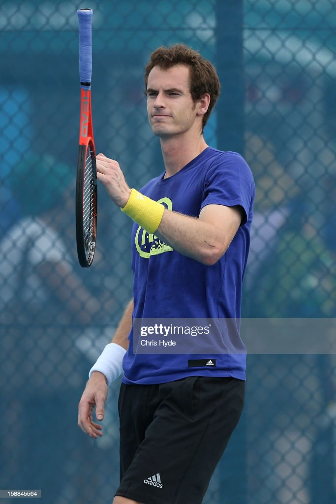 <a gi-track='captionPersonalityLinkClicked' href=/galleries/search?phrase=Andy+Murray+-+Tennisspelare&family=editorial&specificpeople=200668 ng-click='$event.stopPropagation()'>Andy Murray</a> of Great Britain throws his racket during a practice session on day three of the Brisbane International at Pat Rafter Arena on January 1, 2013 in Brisbane, Australia.