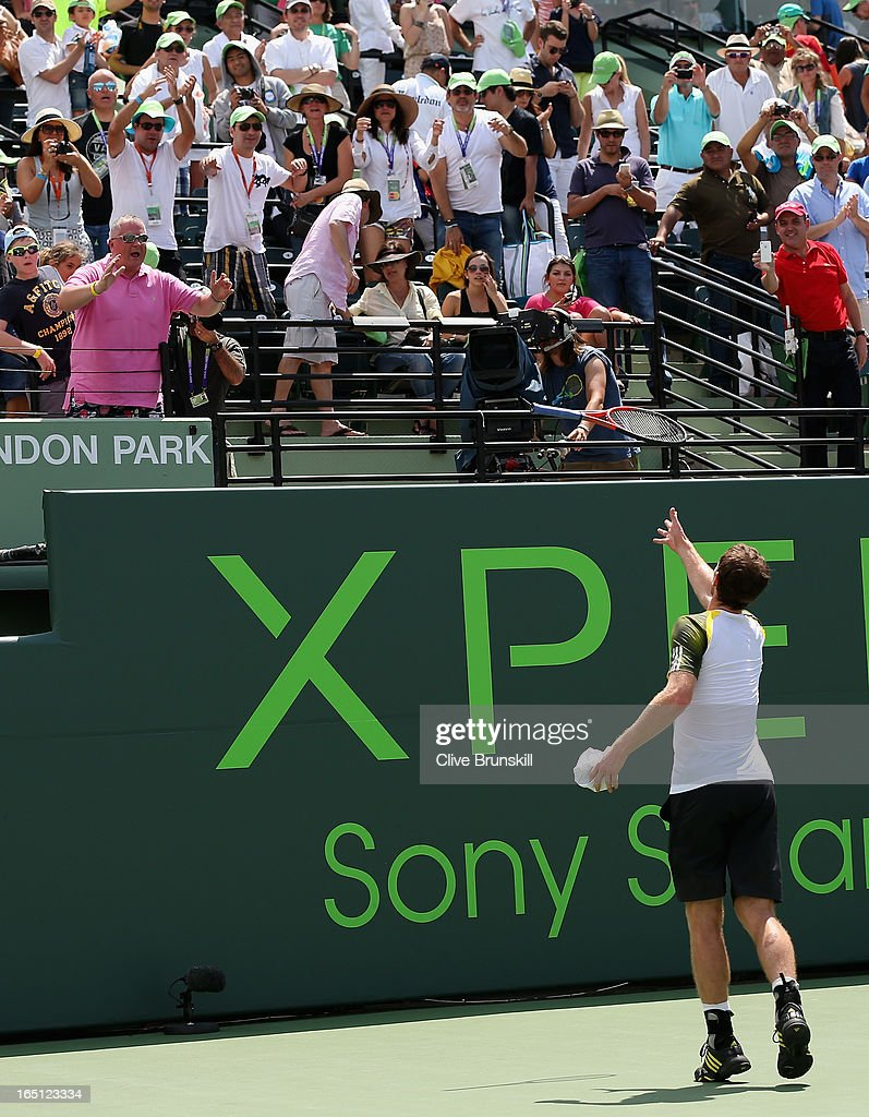 Andy Murray of Great Britain throws his racket to a spectator after his three set victory against David Ferrer of Spain during their final match at the Sony Open at Crandon Park Tennis Center on March 31, 2013 in Key Biscayne, Florida.