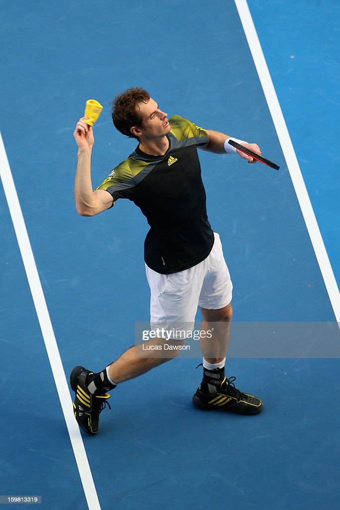 Andy Murray of Great Britain throws his sweat ban into the crowd after winnng his fourth round match against Gilles Simon of France during day eight of the 2013 Australian Open at Melbourne Park on January 21, 2013 in Melbourne, Australia.