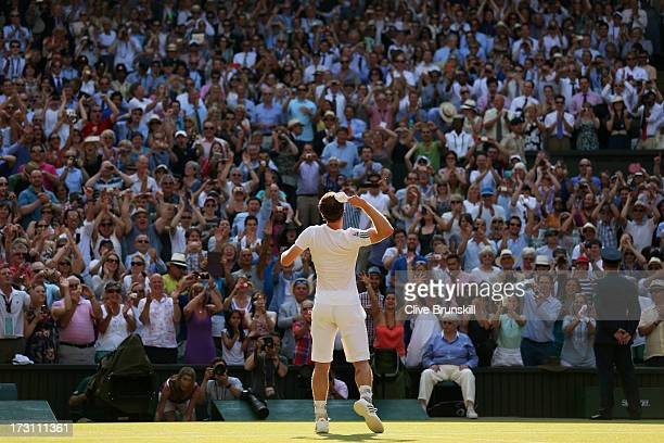 Andy Murray of Great Britain throws his sweatband into the crowd as he celebrates victory during the Gentlemen's Singles Final match against Novak...