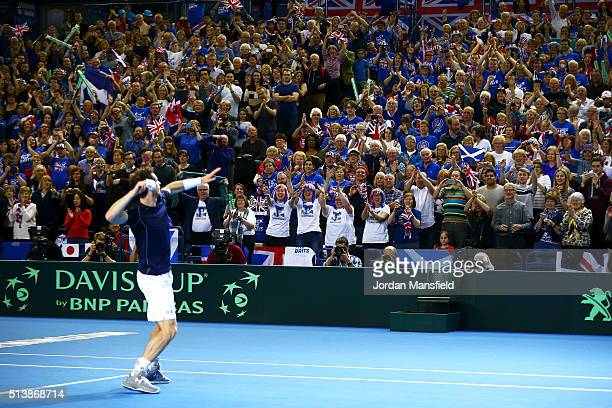 Andy Murray of Great Britain throws his sweatbands into the crowd following victory during the doubles match against Yoshihito Nishioka and Yasutaka...