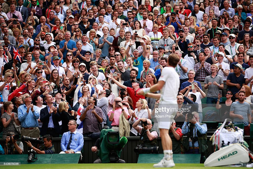 <a gi-track='captionPersonalityLinkClicked' href=/galleries/search?phrase=Andy+Murray+-+Tennis+Player&family=editorial&specificpeople=200668 ng-click='$event.stopPropagation()'>Andy Murray</a> of Great Britain throws his wrist bands to the supporters following victory during the Men's Singles second round match against Yen-Hsun Lu of Taipei on day four of the Wimbledon Lawn Tennis Championships at the All England Lawn Tennis and Croquet Club on June 30, 2016 in London, England.
