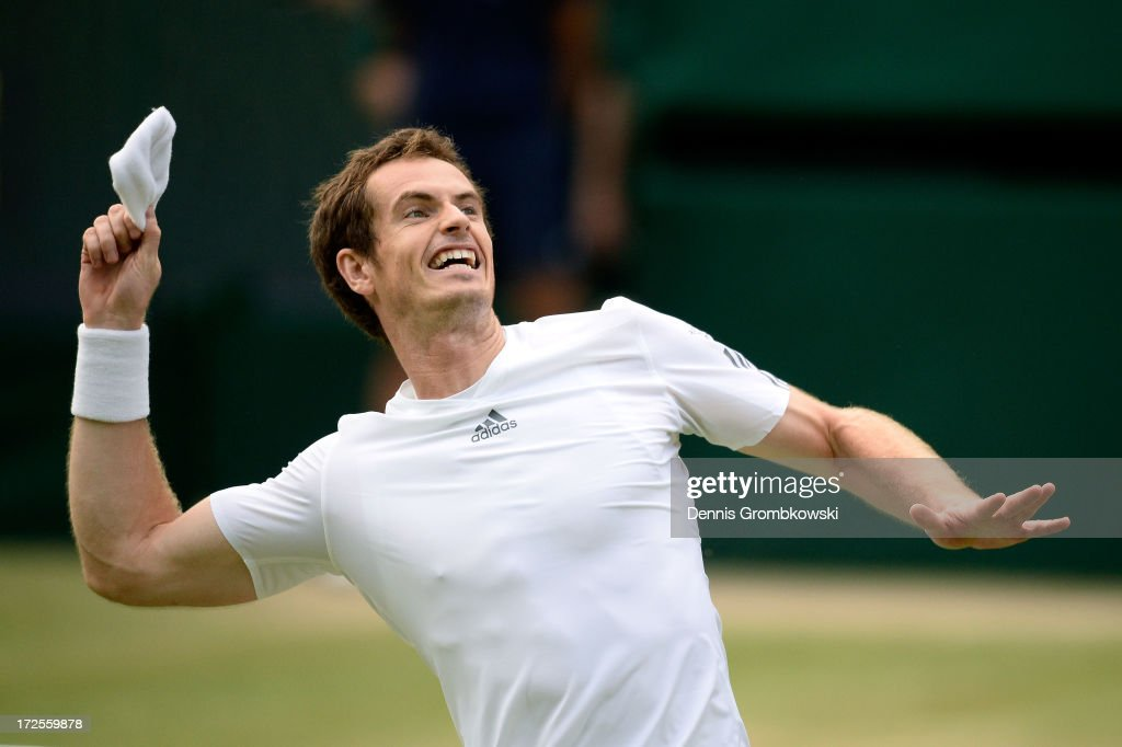 <a gi-track='captionPersonalityLinkClicked' href=/galleries/search?phrase=Andy+Murray+-+Tennis+Player&family=editorial&specificpeople=200668 ng-click='$event.stopPropagation()'>Andy Murray</a> of Great Britain throws his wristband into the crowd as he celebrates match point during the Gentlemen's Singles quarter-final match against Fernando Verdasco of Spain on day nine of the Wimbledon Lawn Tennis Championships at the All England Lawn Tennis and Croquet Club at Wimbledon on July 3, 2013 in London, England.