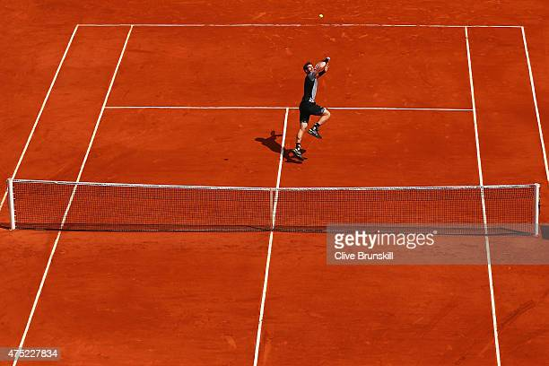 Andy Murray of Great Britain tracks back to return the shot in his Men's Singles match against Nick Kyrgios of Australia on day seven of the 2015...