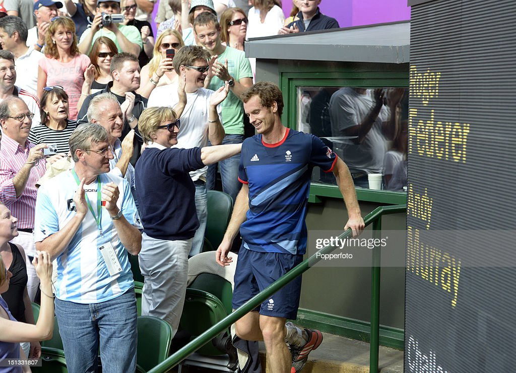 Andy Murray of Great Britain walks back to the court after celebrating with his family and coaching staff after defeating Roger Federer of Switzerland in the Men's Singles Tennis Gold Medal Match on Day 9 of the London 2012 Olympic Games at the All England Lawn Tennis and Croquet Club on August 5, 2012 in London, England.