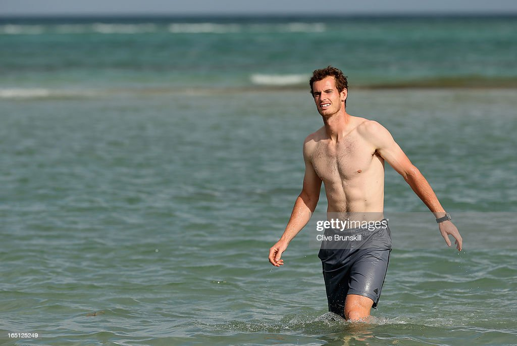 Andy Murray of Great Britain walks in the ocean after his three set victory against David Ferrer of Spain during their final match at the Sony Open at Crandon Park Tennis Center on March 31, 2013 in Key Biscayne, Florida.