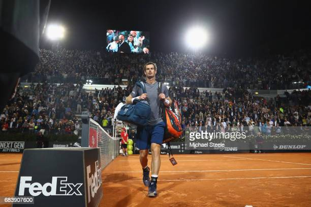 Andy Murray of Great Britain walks off the court after his straight sets defeat during the second round match against Fabio Fognini of Italy on Day...