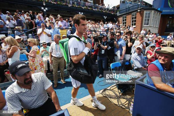 Andy Murray of Great Britain walks onto the court for his match against PaulHenri Mathieu of France on day three of the Aegon Championships at Queens...