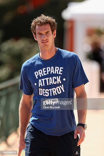 Andy Murray of Great Britain walks to meet the press for interviews in a PrepareAttackDestroy t shirt prior to his second round match during day one...