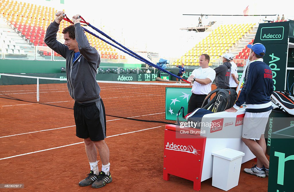 Andy Murray of Great Britain warms up for a late practice session watched by his team captain <a gi-track='captionPersonalityLinkClicked' href=/galleries/search?phrase=Leon+Smith+-+Tennis+Coach&family=editorial&specificpeople=12698515 ng-click='$event.stopPropagation()'>Leon Smith</a> prior to the Davis Cup World Group Quarter Final match between Italy and Great Britain at Tennis Club Napoli on April 3, 2014 in Naples, Italy.