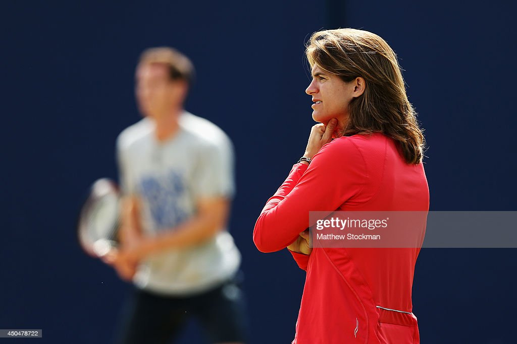 Andy Murray of Great Britain warms up on the practice courts watched by his new coach Amelie Mauresmo on day four of the Aegon Championships at Queens Club on June 12, 2014 in London, England.