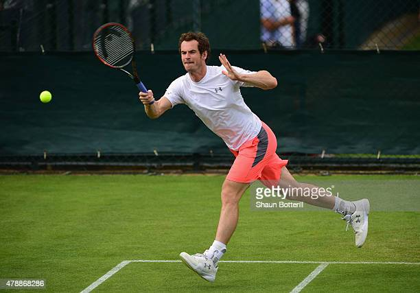 Andy Murray of Great Britain warmsup during a pratice session prior to the Wimbledon Lawn Tennis Championships at the All England Lawn Tennis and...