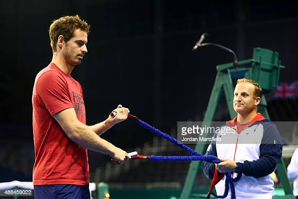 Andy Murray of Great Britain warmsup with Physio Matt Little during a practice session at Emirates Arena on September 16 2015 in Glasgow Scotland
