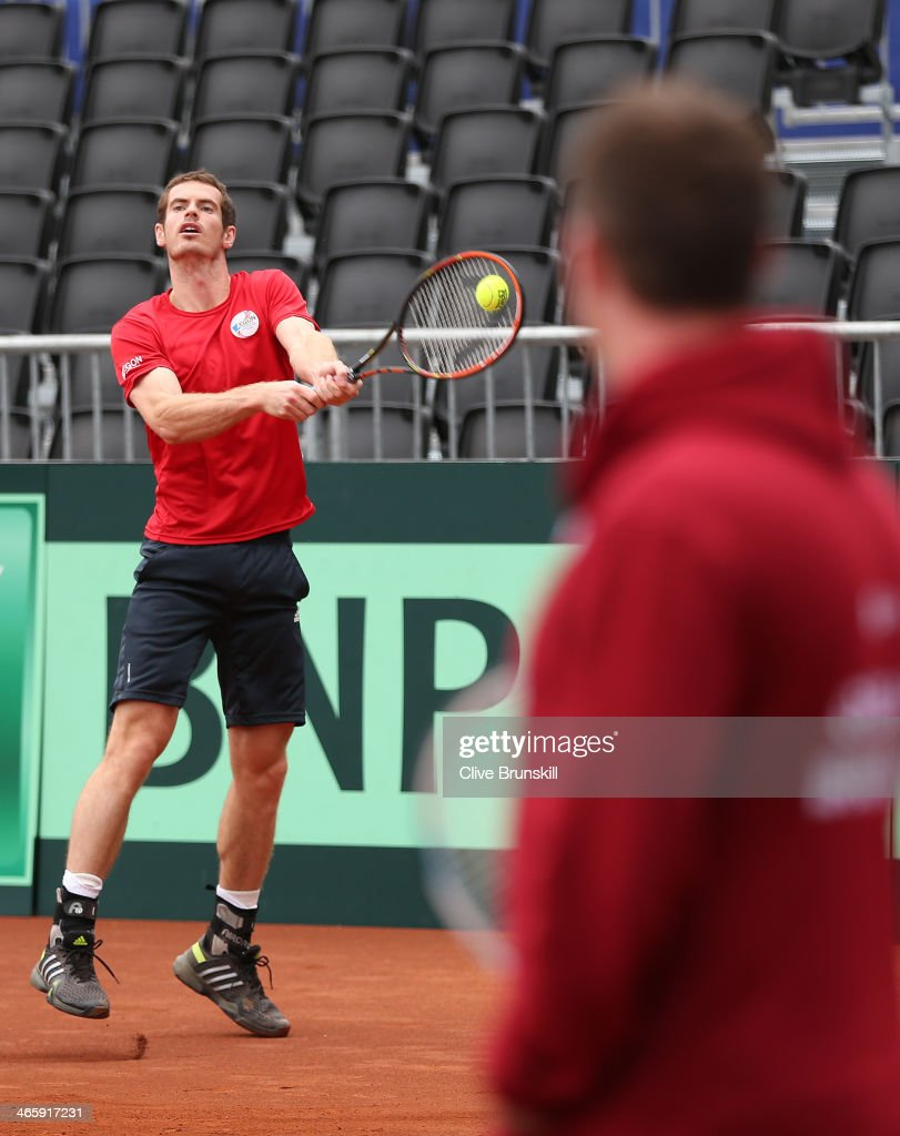 Andy Murray of Great Britain watched by captain <a gi-track='captionPersonalityLinkClicked' href=/galleries/search?phrase=Leon+Smith+-+Tennis+Coach&family=editorial&specificpeople=12698515 ng-click='$event.stopPropagation()'>Leon Smith</a> practices before his first round match against the United States prior to the Davis Cup World Group first round between the U.S. and Great Britain at PETCO Park on January 30, 2014 in San Diego, California.