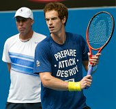 Andy Murray of Great Britain watched by his coach Ivan Lendl during a practice session on day nine of the 2013 Australian Open at Melbourne Park on...
