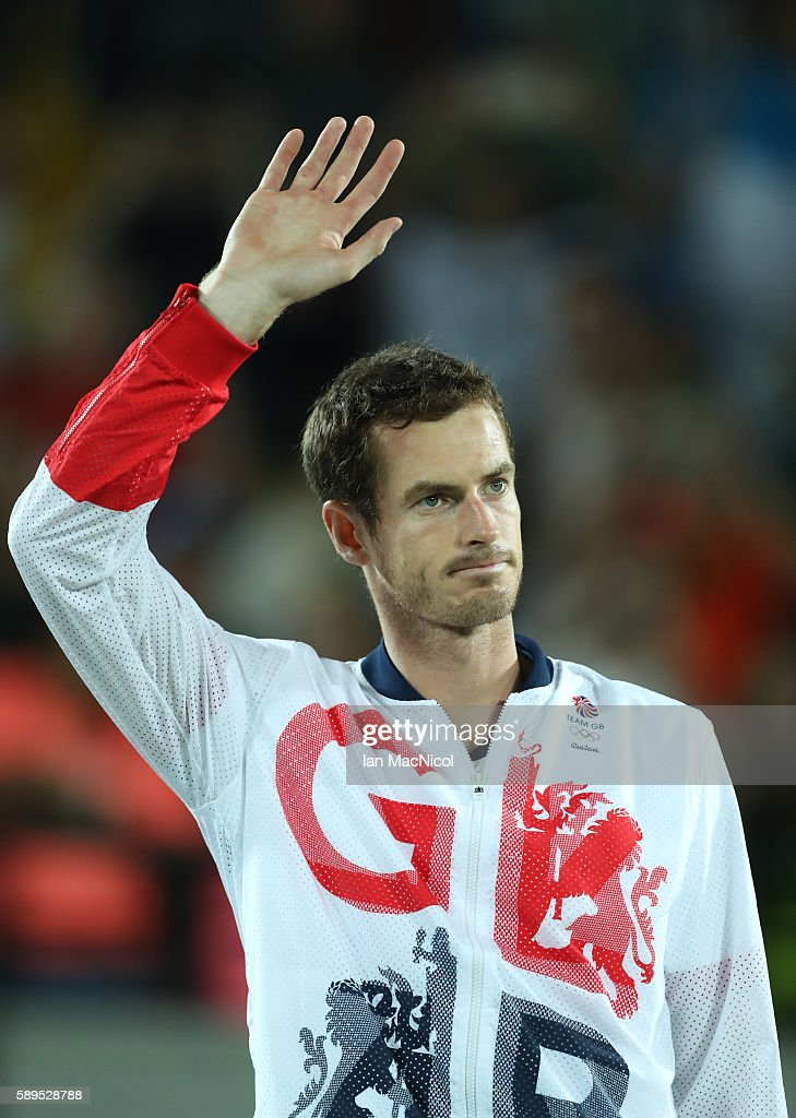 Andy Murray of Great Britain waves on the podium after his match with Juan Martin del Potro of Argentina in the Men's singles final at Olympic Tennis Centre on August 14, 2016 in Rio de Janeiro, Brazil.