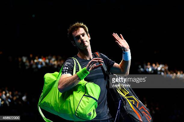 Andy Murray of Great Britain waves to the crowd after defeat in the round robin singles match against Roger Federer of Switzerland on day five of the...